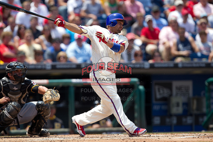 Philadelphia Phillies outfielder Shane Victorino #8 swings during the Major League Baseball game against the Pittsburgh Pirates on June 28, 2012 at Citizens Bank Park in Philadelphia, Pennsylvania. The Pirates defeated the Phillies 5-4. (Andrew Woolley/Four Seam Images).