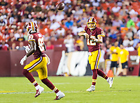 Landover, MD - August 16, 2018: Washington Redskins quarterback Colt McCoy (12) throws a pass to Washington Redskins wide receiver Brian Quick (83) during preseason game between the New York Jets and Washington Redskins at FedEx Field in Landover, MD. (Photo by Phillip Peters/Media Images International)