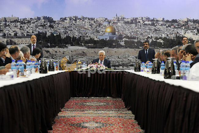 Palestinian President Mahmoud Abbas speaks during a meeting of the Palestinian leadership at his headquarter in the West Bank city of Ramallah, on March 31, 2014. Photo by Thaer Ganaim