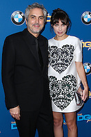 CENTURY CITY, CA - JANUARY 25: Alfonso Cuaron, Sheherazade Goldsmith at the 66th Annual Directors Guild Of America Awards held at the Hyatt Regency Century Plaza on January 25, 2014 in Century City, California. (Photo by Xavier Collin/Celebrity Monitor)