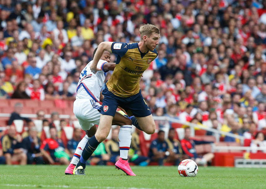 Arsenal's Per Mertesacker<br /> <br /> Photographer Kieran Galvin/CameraSport<br /> <br /> Football - Emirates Cup - Arsenal v Olympique Lyonnais - Saturday 25th July 2015 - Emirates Stadium - London <br /> <br /> &copy; CameraSport - 43 Linden Ave. Countesthorpe. Leicester. England. LE8 5PG - Tel: +44 (0) 116 277 4147 - admin@camerasport.com - www.camerasport.com