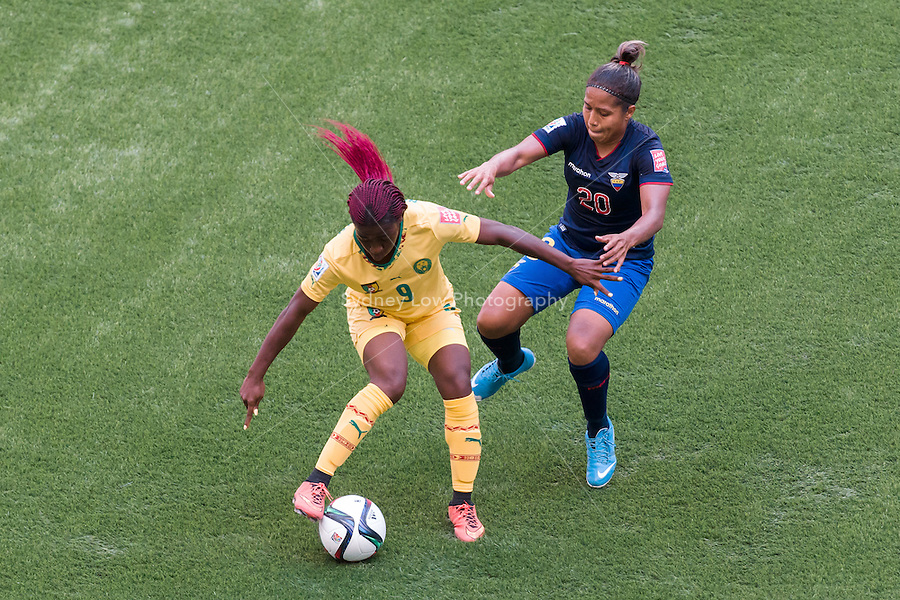 June 8, 2015: Madeleine NGONO MANI of Cameroon and Denise PESANTES of Ecuador fight for the ball during a Group C match at the FIFA Women's World Cup Canada 2015 between Cameroon and Ecuador at BC Place Stadium on 8 June 2015 in Vancouver, Canada. Sydney Low/AsteriskImages