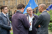 Chucka Ummuna MP interviewed by BBC Radio journalist Nick Robinson on College Green, Westminster, London, on the day of four ministerial resignations over Brexit deal.