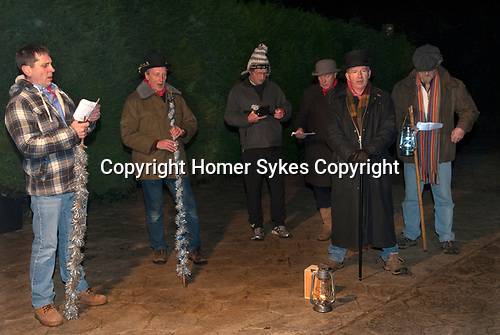 """Drayton Somerset, traditional house visiting Wassailers who travel around the village on old New Years Eve, January 5th, singing a traditional wassailing song, and bidding the house holders """"..........."""", before being invited in for refreshment.  UK.  2017"""