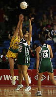 15.11.2007 Cook Islands Sheena Tavioni and Australian Liz Ellis compete for the ball during the Australia v Cook Islands match at the New World Netball World Champs held at Trusts Stadium Auckland New Zealand. Mandatory Photo Credit ©Michael Bradley.