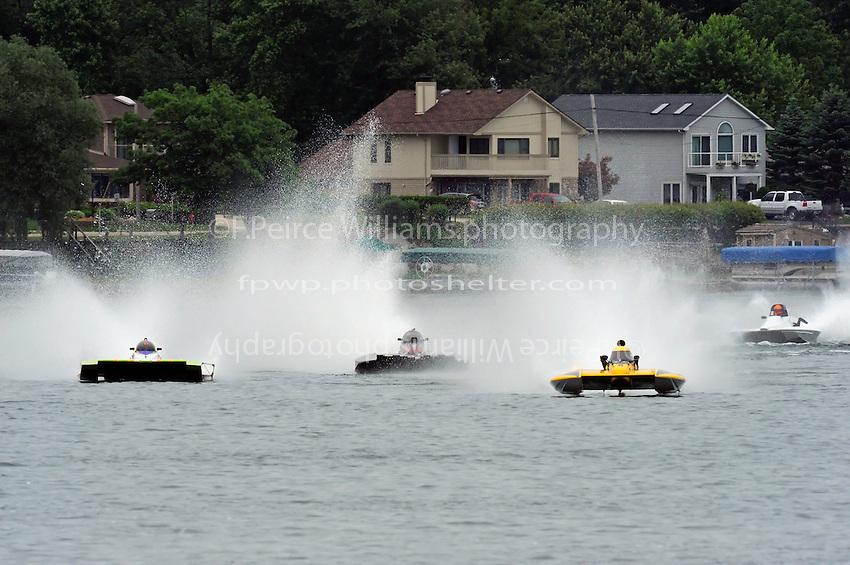 "13-14 June, 2009, APBA Inboards, Walled Lake, Novi, MI. USA.Nicky Pellerin, E-81 ""Crazy Cajun"", 5 Litre hydroplane,Mark Burghardt, E-726 ""X-Ray"", 5 Litre hydroplaneTom Thompson, E-816 ""Batt Boat"", 5 Litre hydroplane.©F. Peirce Williams 2009 USA.F.Peirce Williams.photography.ref: RAW (.NEF) File Available"