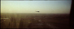 An Army Black Hawk helicopter flies across the mountainous desert between Kirkuk and Tikrit - the frontiers between Kurdish and Sunni Iraq -  on Tues. Dec. 6, 2006.<br />