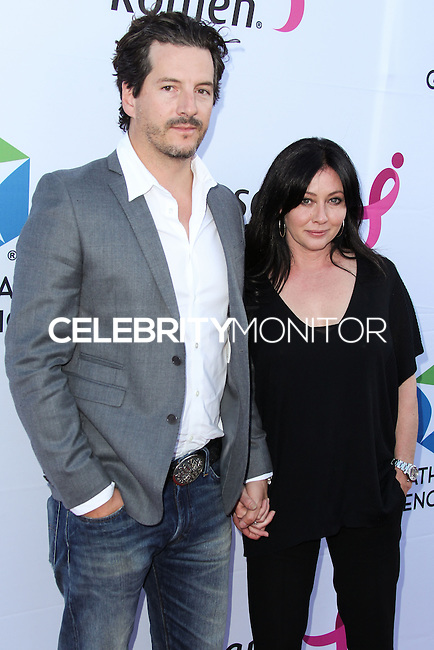 SANTA MONICA, CA, USA - JUNE 11: Kurt Iswarienko, Shannon Doherty at the Pathway To The Cures For Breast Cancer: A Fundraiser Benefiting Susan G. Komen held at the Barker Hangar on June 11, 2014 in Santa Monica, California, United States. (Photo by Xavier Collin/Celebrity Monitor)