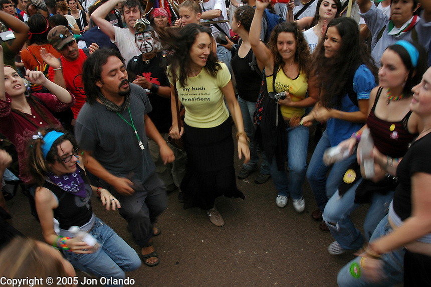 Demonstrators take part in an impromtu dance party during an anti-war protest in Washington, DC in September of 2005