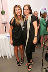 "Nina Garcia and Rose Tous pose during Nina Garcia's ""Look Book: What To Wear For Every Occasion"", book release party with Marie Claire at Tous Rockefeller Center, August 17, 2010."