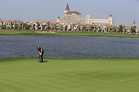 Jamie Donaldson (WAL) putts on the 6th green during Sunday's Final Round of the 2014 BMW Masters held at Lake Malaren, Shanghai, China. 2nd November 2014.<br /> Picture: Eoin Clarke www.golffile.ie