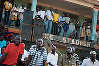 Spectators watch a soccer game during a tournament at Pece Stadium, Gulu District.
