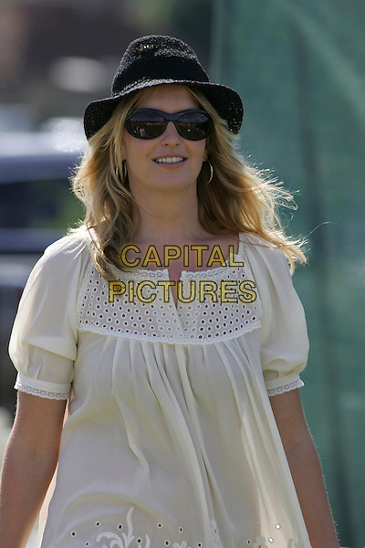 PENNY LANCASTER - PENNY STEWART.at the Veuve Clicquot Gold Cup Polo, .at the Cawdrey Park Polo Ground in East Sussex,.England, 22 July 2007..half length white cream tunic dress black hat sunglasses .CAP/CAS.©Bob Cass/Capital Pictures.