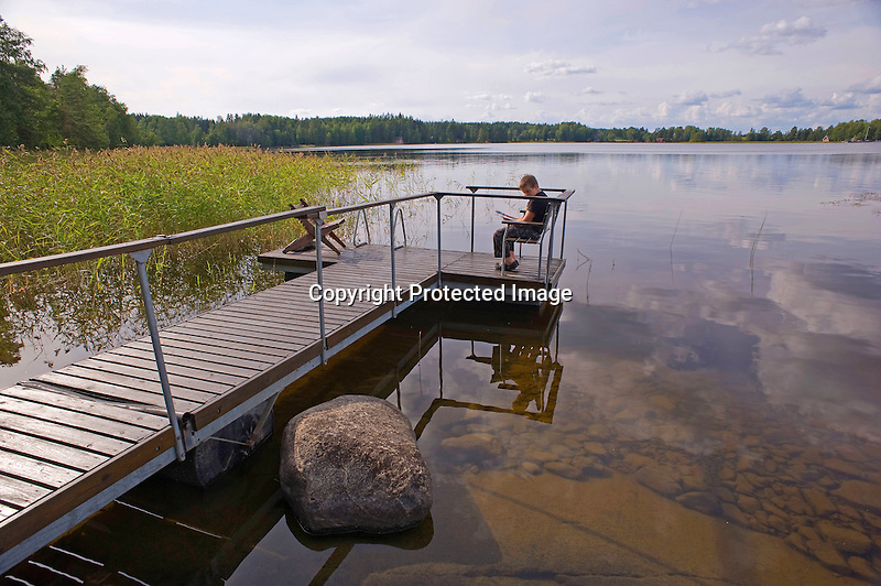 Young Boy Enjoying Summer at the Lake in Rural Finland
