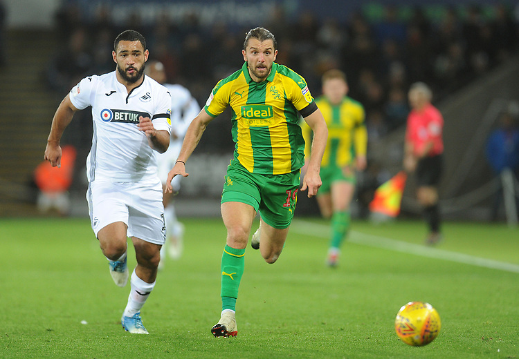 West Bromwich Albion's Jay Rodriguez vies for possession with Swansea City's Cameron Carter-Vickers<br /> <br /> Photographer Kevin Barnes/CameraSport<br /> <br /> The EFL Sky Bet Championship - Swansea City v West Bromwich Albion - Wednesday 28th November 2018 - Liberty Stadium - Swansea<br /> <br /> World Copyright © 2018 CameraSport. All rights reserved. 43 Linden Ave. Countesthorpe. Leicester. England. LE8 5PG - Tel: +44 (0) 116 277 4147 - admin@camerasport.com - www.camerasport.com