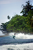 INDONESIA, Mentawai Islands, Kandui Resort, a man surfing a wave, Nupssy