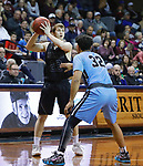 SIOUX FALLS, SD - MARCH 9:  Alex Borchers #22 of Morningside looks to pass the ball as he runs into Warner Pacific defender Xavier Cannefax #32 at the 2018 NAIA DII Men's Basketball Championship at the Sanford Pentagon in Sioux Falls. (Photo by Dick Carlson/Inertia)