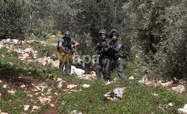 Israeli soldiers fire tear gas towards Palestinian protesters during clashes with israeli security forces following a protest against the expropriation of Palestinian land by Israel on March 15, 2013, in the village of Kafr Qaddum, near the occupied West Bank city of Nablus. Photo by Nedal Eshtayah