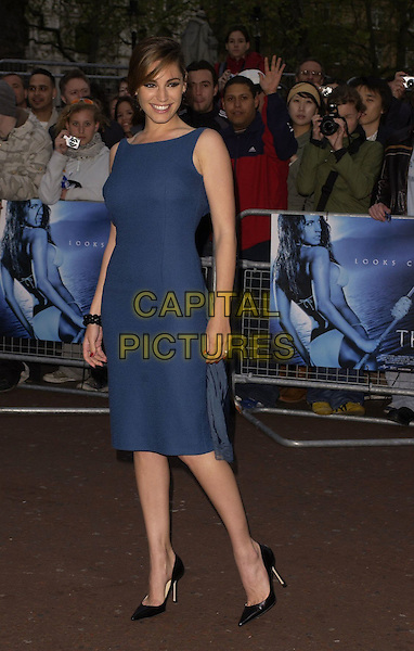 """KELLY BROOK.World Premiere of """"Three"""" at the Odeon West End, Leicester Square, London, UK..May 2nd, 2006.Ref: CAN.full length blue dress sleeveless black shoes stilettoes.www.capitalpictures.com.sales@capitalpictures.com.©Capital Pictures"""