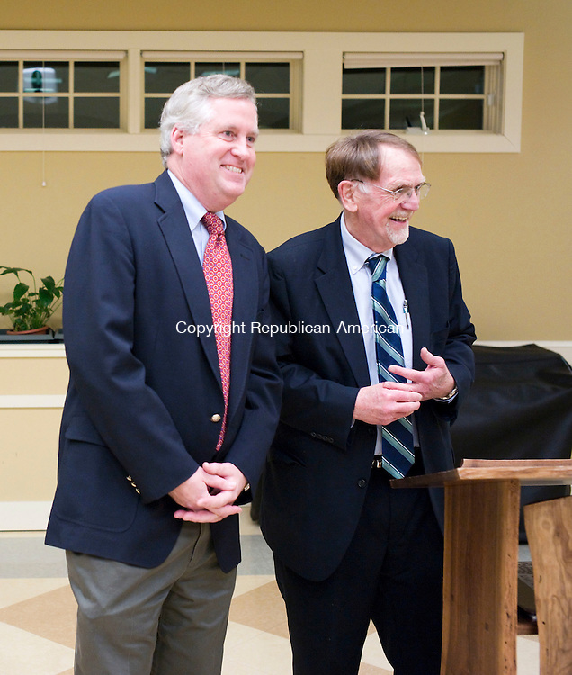 Woodbury, CT- 06 December 2015-120615CM18- From left, Woodbury town attorney, Thomas Kaelin and Woodbury First Selectman, Bill Butterly share a laugh during a swearing in ceremony at the Woodbury Senior Center on Sunday.  27 town officials were sworn in ahead of the first meeting of the new Board of Selectmen, which will be held on Monday.   Christopher Massa Republican-American