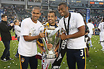 01 December 2012: Los Angeles' three Brazilian players pose with the Philip F. Anschutz Trophy. From left: Leonardo (BRA), Juninho (BRA), David Junior Lopes (BRA). The Los Angeles Galaxy played the Houston Dynamo at the Home Depot Center in Carson, California in MLS Cup 2012. Los Angeles won the game 3-1.