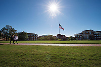 Drill field sidewalk with sun and flag.<br />  (photo by Megan Bean / &copy; Mississippi State University)