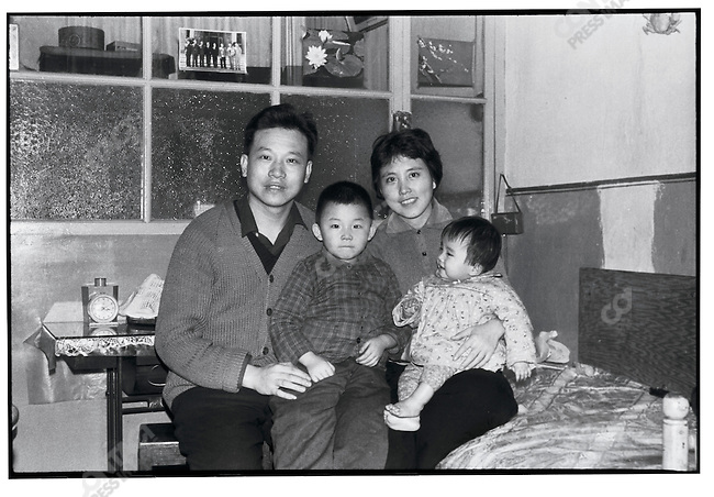 Li Zhensheng with wife Zhu Yingxia, their son Xiaohan and daughter Xiaobing in their new home in the provincial capital; photographed by Li using a self-timer; Harbin, Heilongjiang Province, September 28, 1972