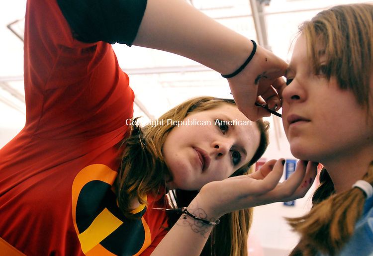MIDDLEBURY, CT- 11 JANUARY 2008 --011109JS07-FOR COUNTRY LIFE-Westover student Mackenzie Dix of Old Lyme, paints a spider on the cheek of Sophia DeVivo, 11, of Newtown during the annual Dorcas Fair held Sunday at the Westover School, The event, now in its 100th year, is a fundraiser organized by the junior class. Money raised from the event is donated to charitable groups.<br /> Jim Shannon / Republican-American