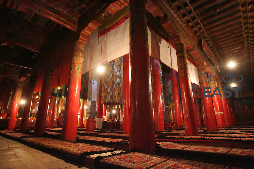 Red pillars stand in a prayer room of Kunghua monastery, in Tibetan region, China, on March 22, 2008. Kunghua monastery has been surrounded by Chinese police and its monks forced to stay inside in order to prevent them to join the Tibetan protesting movement that started on March 10. Photo by Lucas Schifres/Pictobank