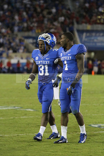 Mikie Benton and Martavius Neloms check the scoreboard during the University of Kentucky football game against Western Kentucky University, and Commonwealth Stadium in Lexington, Ky., on Saturday September 15th. Photo by Kirsten Holliday