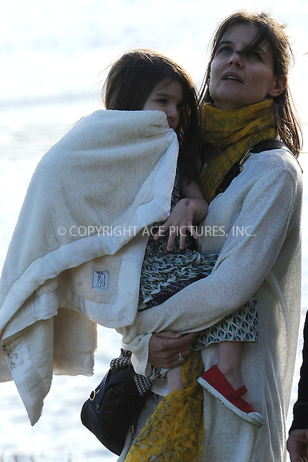 WWW.ACEPIXS.COM . . . . . ....October 10 2009, Boston....Actor Katie Holmes and daughter Suri have fun in a Boston park. Tom Cruise is in Boston to shoot a movie. October 10 2009, Boston, MA....Please byline: KRISTIN CALLAHAN - ACEPIXS.COM.. . . . . . ..Ace Pictures, Inc:  ..(212) 243-8787 or (646) 679 0430..e-mail: picturedesk@acepixs.com..web: http://www.acepixs.com