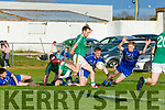 Padraig Boyle Ballyduff slams home despite the efforts of Renard Alan Curran and Kevin Curranl for the match winning goal in the Junior Club Championship final in Killorglin on Saturday