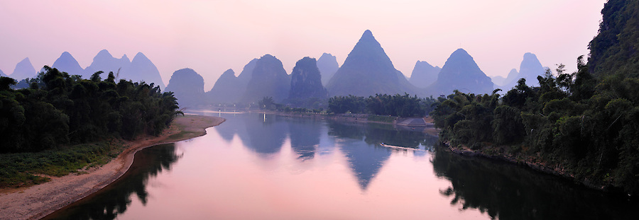 Sunrise over Lijiang River and karst mountains, Yangshuo, Guanxi, China