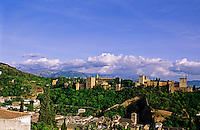 Spain, Andalucia, Granada.  Evening light on the Alhambra, the finest remaining example of Moorish architecture in Spain.  Built between the 9th and 14th Centuries.  The Sierra Nevada mountains in the background.