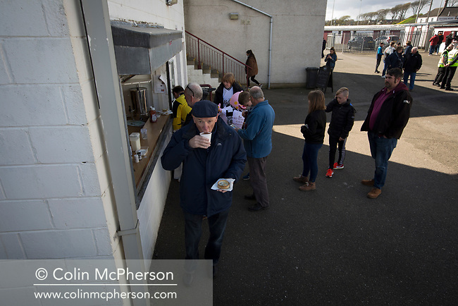 Fans buying refreshments during the first-half at Gayfield Park as Arbroath hosted Edinburgh City (in yellow) in an SPFL League 2 fixture. The newly-promoted side from the Capital were looking to secure their place in SPFL League 2 after promotion from the Lowland League the previous season. They won the match 1-0 with an injury time goal watched by 775 spectators to keep them 4 points clear of bottom spot with three further games to play.
