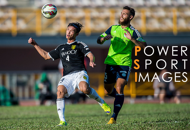Jinghuang Deng of Sun Pegasus FC (L) competes for the ball with Vincent Lucas Weijl of Wofoo Tai Po (R) during the HKFA Premier League between Wofoo Tai Po vs Sun Pegasus at the Tai Po Sports Ground on 22 November 2014 in Hong Kong, China. Photo by Aitor Alcalde / Power Sport Images
