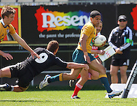 Kenneth Robertson tries to brush off the tackle of Tawera Kerr-Barlow during the International rugby match between New Zealand Secondary Schools and Suncorp Australia Secondary Schools at Yarrows Stadium, New Plymouth, New Zealand on Friday, 10 October 2008. Photo: Dave Lintott / lintottphoto.co.nz