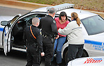 Shoting suspect Amy Bishop (pink sweater) in custody.  Shooting on UAHuntsville campus at Shelby Center Feb. 12, 2010. Three faculty members killed, three more wounded.   Bob Gathany / The Huntsville Times