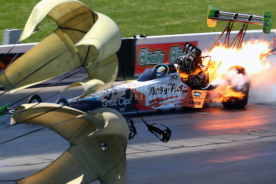 May 21, 2017; Topeka, KS, USA; NHRA top fuel driver Clay Millican explodes an engine on fire during the Heartland Nationals at Heartland Park Topeka. Mandatory Credit: Mark J. Rebilas-USA TODAY Sports