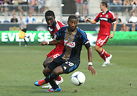 CHESTER, PA - AUGUST 12, 2012:  Raymon Gaddis (28) of the Philadelphia Union turns the ball away from  Jalil Anibaba (6) of the Chicago Fire during an MLS match at PPL Park, in Chester, PA on August 12. Fire won 3-1.