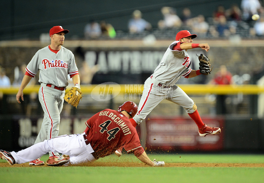 Apr. 25, 2012; Phoenix, AZ, USA; Philadelphia Phillies infielder Freddy Galvis throws to first base to complete the double play after forcing out Arizona Diamondbacks base runner (44) Paul Goldschmidt in the seventh inning at Chase Field. Mandatory Credit: Mark J. Rebilas-