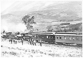 #418 C-19 and #100 Class 42 with RPO and passenger car at La Veta Pass.  Group of men standing outside train.<br /> D&amp;RG  La Veta Pass, CO  Taken by Kilbourn Studios, Salida, CO