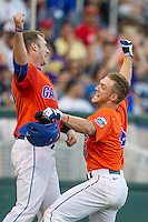 Florida Gators outfielder Harrison Bader (8) celebrates after hitting a home run against the Virginia Cavaliers in Game 13 of the NCAA College World Series on June 20, 2015 at TD Ameritrade Park in Omaha, Nebraska. The Cavaliers beat the Gators 5-4. (Andrew Woolley/Four Seam Images)