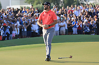 Jon Rahm (ESP) holes the winning putt on the 18th green during the final round of the DP World Championship, Earth Course, Jumeirah Golf Estates, Dubai, UAE. 24/11/2019<br /> Picture: Golffile | Phil INGLIS<br /> <br /> <br /> All photo usage must carry mandatory copyright credit (© Golffile | Phil INGLIS)