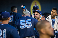 Corpus Christi Hooks designated hitter Granden Goetzman (55) is congratulated by teammates in the dugout following a solo home run Wednesday, May 1, 2019, at Arvest Ballpark in Springdale, Arkansas. (Jason Ivester/Four Seam Images)