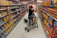 """Rabbi Yaakov Rapoport, Director of Chabad House Lubavitch at Syracuse University, shops for kosher party supplies at Price Chopper while preparing for a Hoshana Rabbah celebration. Hoshana Rabbah is the seventh day of Sukkot and is considered the final day of the divine """"judgment"""" in which the fate of the new year is determined.  Photo by James R. Evans ©"""