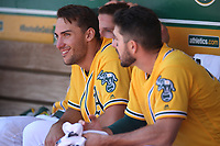 OAKLAND, CA - MAY 9:  Matt Olson #28 of the Oakland Athletics smiles in the dugout during the game against the Houston Astros at the Oakland Coliseum on Wednesday, May 9, 2018 in Oakland, California. (Photo by Brad Mangin)
