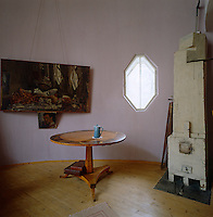 "Melnikov designed this, his dream house, ""starting with the stove"" and the painting is an interior of the house"