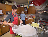 STAFF PHOTO BEN GOFF  @NWABenGoff -- 09/28/14 Amy Mortimeyer volunteers in the kitchen during a meal at First United Methodist Church in Rogers served by volunteers with Samaritan Community Center as a way for church members to learn about the center and it's work on Sunday September 28, 2014. The meal is part of a series of events examining the hunger problem in Northwest Arkansas.