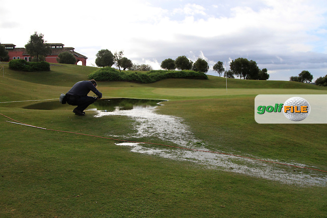 Rain water at the back of the 9th green during Round 1 of the NH Collection Open at the La Reserva de Sotogrande Club de Golf in Cadiz Spain on Thursday 3rd April 2014<br /> Picture:  Thos Caffrey / www.golffile.ie